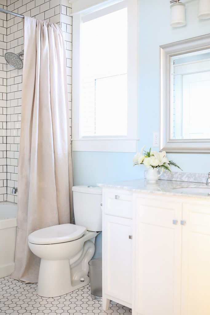 Black and white bathroom - love the white subway tile with black grout and the blue walls kellyelko.com