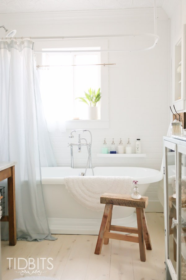 Cottage bathroom - love the freestanding bathtub and rustic wood stool kellyelko.com