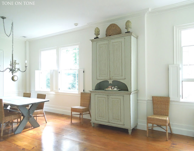 Antique pine floors stand out in a white dining room kellyelko.com