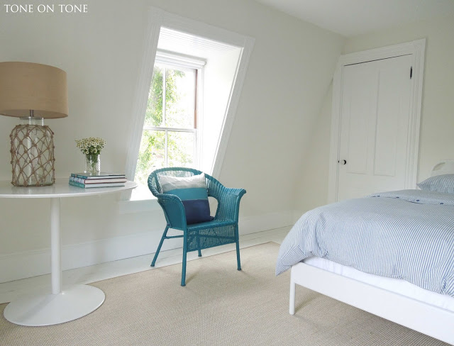 Attic bedroom - love the pop of color from the peacock blue chair kellyelko.com