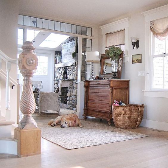 Love the antique newel post in this coastal home tour kellyelko.com