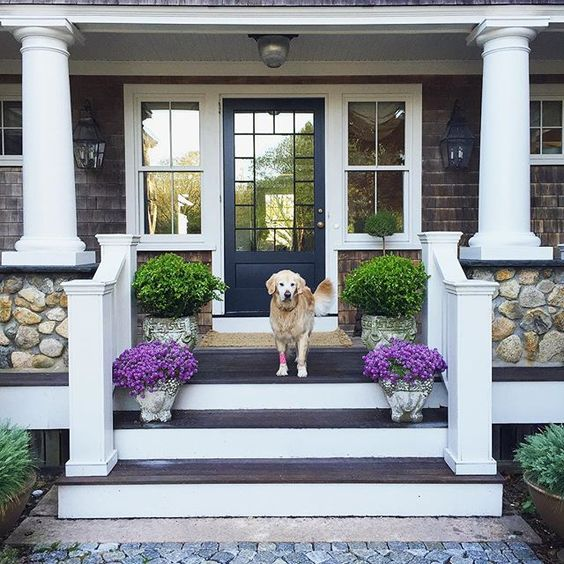 Classic stone and wood coastal porch kellyelko.com