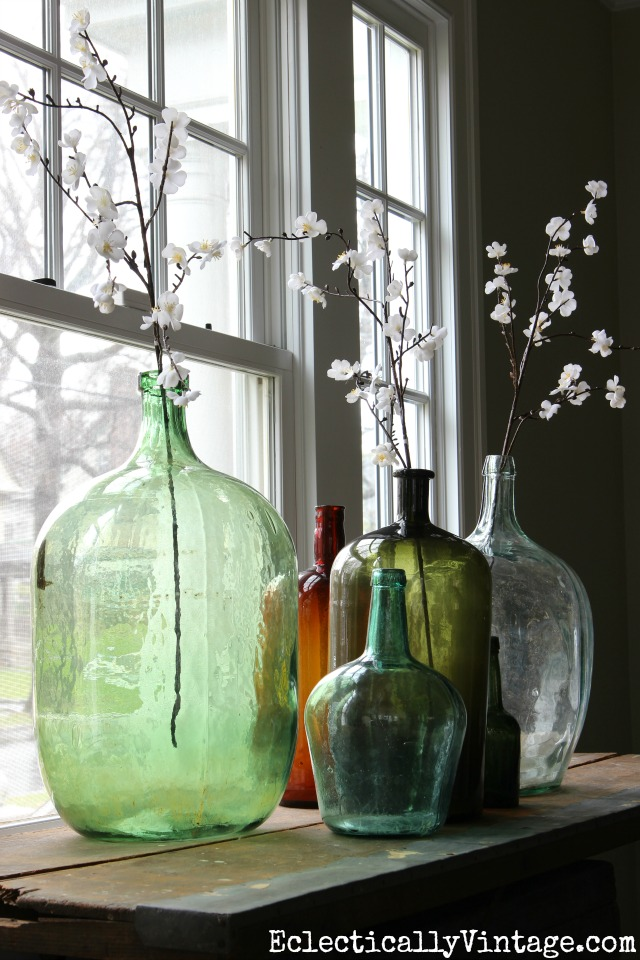 Demijohn collection with spring flowers kellyelko.com #spring #springdecor #springdecorating #springcrafts #hometour #housetour #eclectichome #farmhousedecor #fixerupperstyle #farmhousestyle #vintagedecor #vintagehome #kellyelko #vintageglass #collections #springflowers #vintagecollection #demijohn