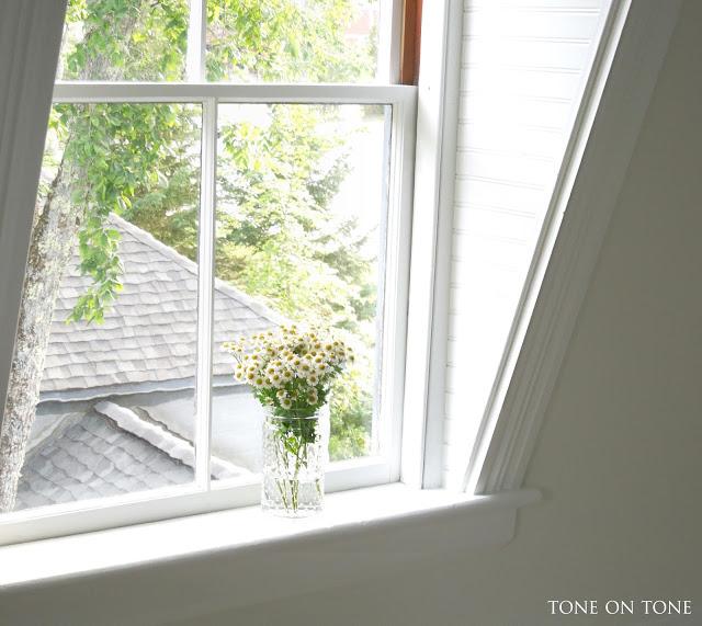 Dormer windowsill with flowers kellyelko.com