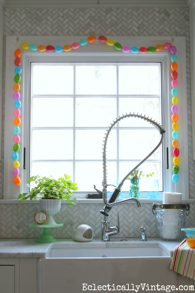 Spring Home Decorating Tour - tons of great ideas to freshen up your home like the colorful DIY egg garland kellyelko.com #spring #springdecor #springdecorating #springcrafts #hometour #housetour #eclectichome #farmhousedecor #fixerupperstyle #jadeite #farmhousestyle #vintagedecor #vintagehome #kellyelko #diygarland #diycrafts #springcrafts #kidscrafts #eastereggs
