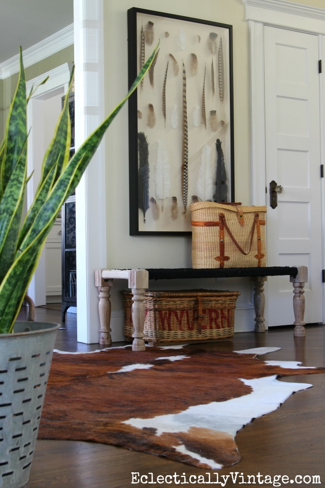 Foyer with cowhide rug and feather art kellyelko.com