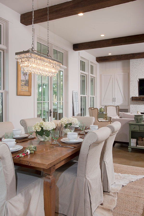 Farmhouse dining room with parsons chairs and crystal chandelier kellyelko.com