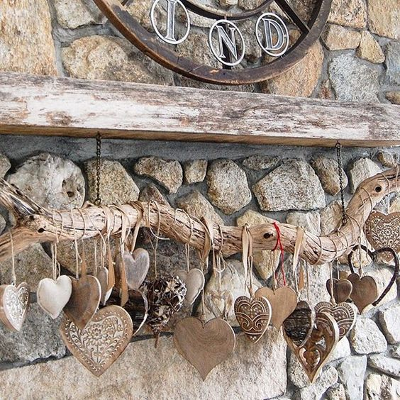 Heart collection hung from a rustic branch kellyelko.com