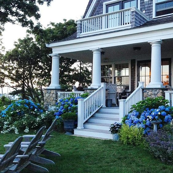 Classic coastal home - love the hydrangeas kellyelko.com