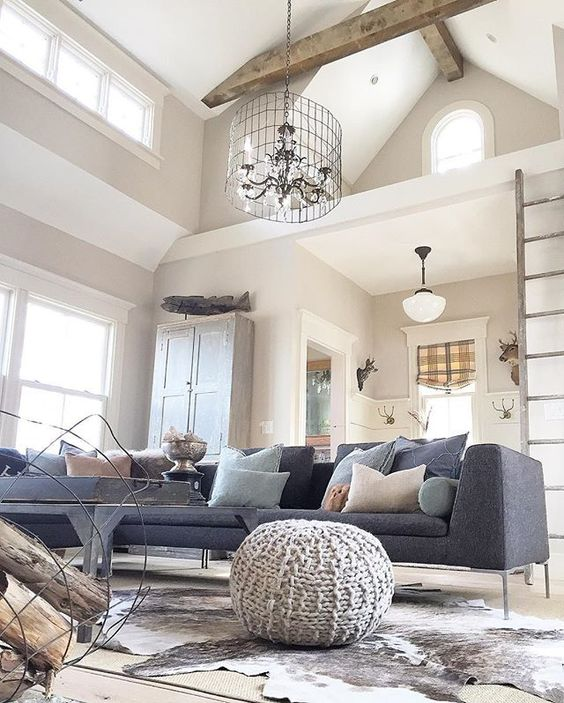 Love the beamed ceiling, wire chandelier and modern furniture in this eclectic family room kellyelko.com