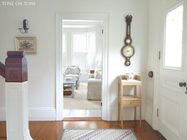 Neutral white entry with beautiful antique pine floors kellyelko.com