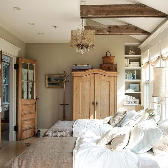 Charming neutral guest bedroom - love the wood ceiling beams kellyelko.com