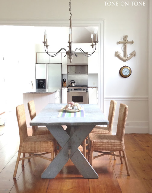 Love the rattan dining chairs and farm table kellyelko.com