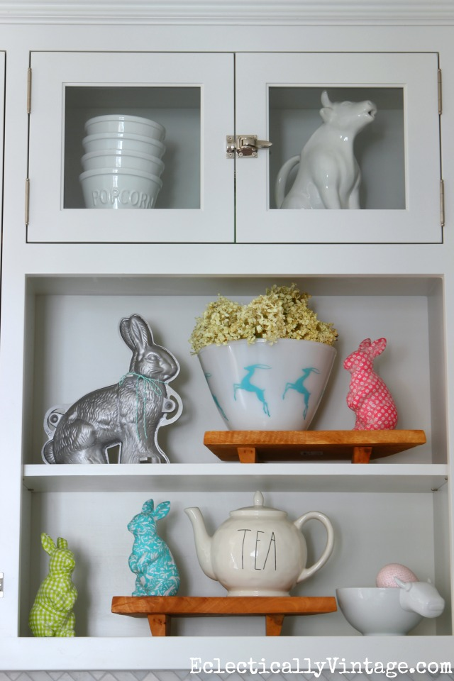 Spring decor - love the colorful bunnies and the vintage gazelle bowl kellyelko.com #spring #springdecor #springdecorating #springcrafts #hometour #housetour #eclectichome #farmhousedecor #fixerupperstyle #jadeite #farmhousestyle #vintagedecor #vintagehome #kellyelko #easterdecor #whitekitchen #shelfie #springbunnies #vintagedecor