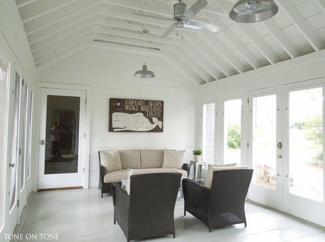 Beautiful breezeway makes the perfect sunroom - love the exposed beams and the galvanized ceiling fan kellyelko.com