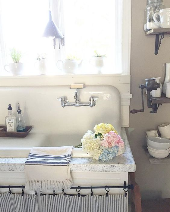 Antique drainboard sink in this charming farmhouse kitchen kellyelko.com