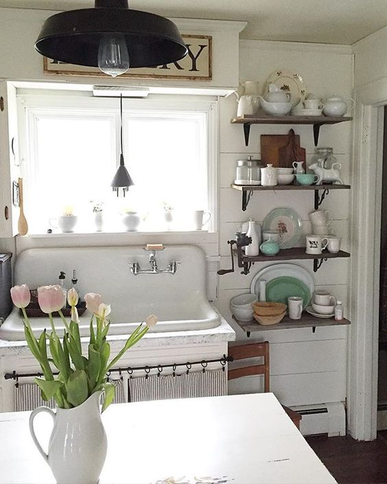 Antique farmhouse kitchen with shiplap walls and antique sink kellyelko.com
