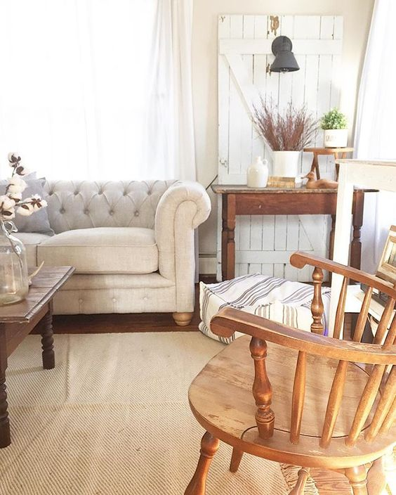 Love this chesterfield sofa and the chippy old door with sconce kellyelko.com
