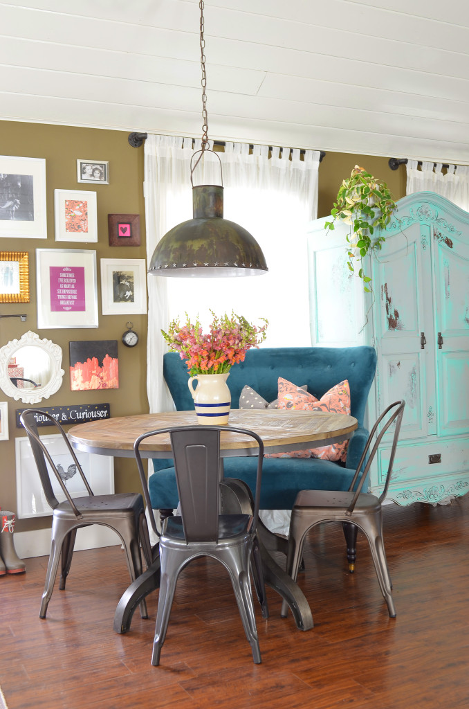 Colorful dining area - love her colorful, eclectic style and the blue settee kellyelko.com