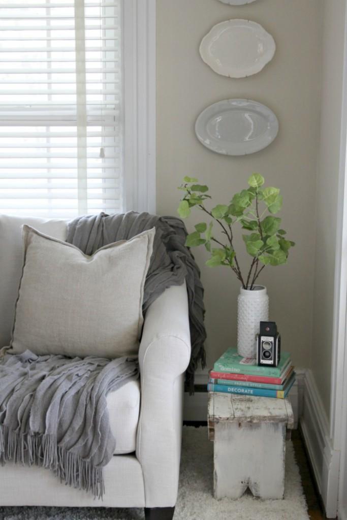 Cozy sofa with gray throw blanket kellyelko.com