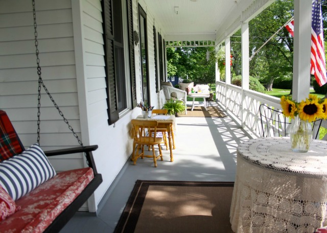 Eclectic home tour love of home blog for Farmhouse porch swing