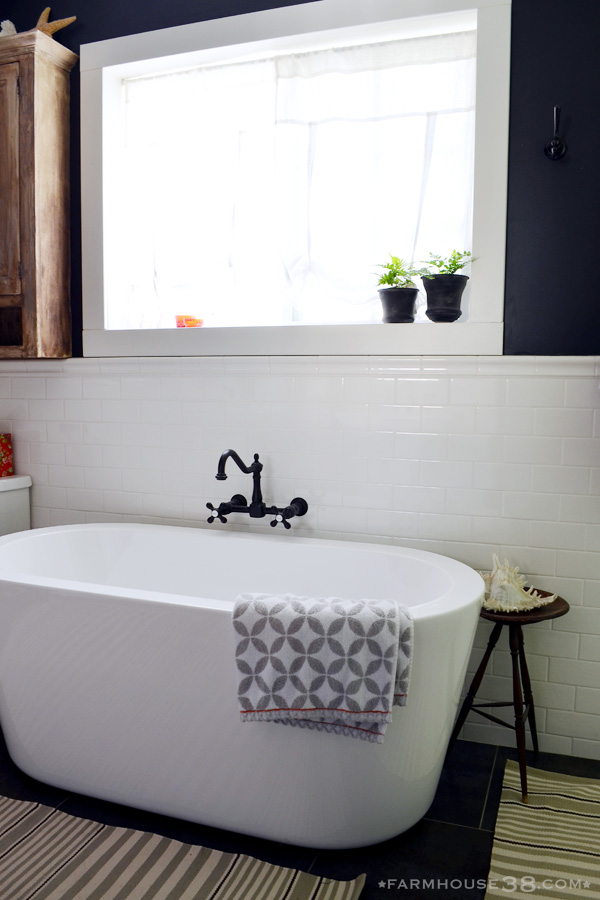 Modern bathtub - love the bold wall color kellyelko.com