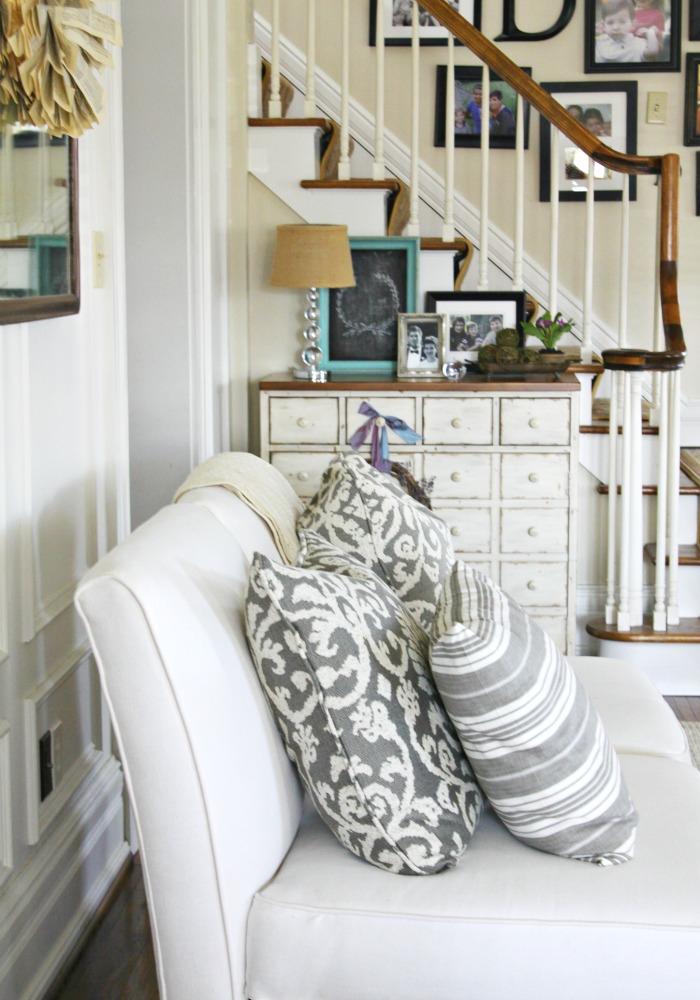 Neutral living room - love the gray pillows kellyelko.com