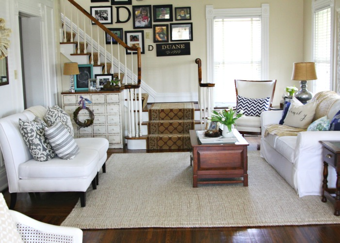 Love this neutral living room and the staircase gallery wall kellyelko.com