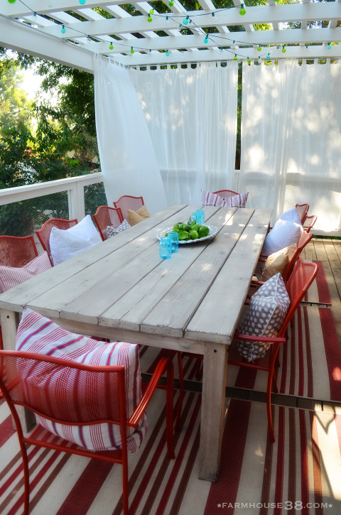 Create a cozy outdoor dining space with a pergola - love the big farm table and red chairs kellyelko.com