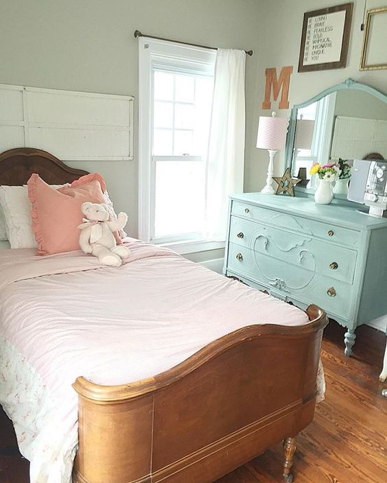Such a cute farmhouse girls bedroom - love the antique bed and the painted blue dresser kellyelko.com