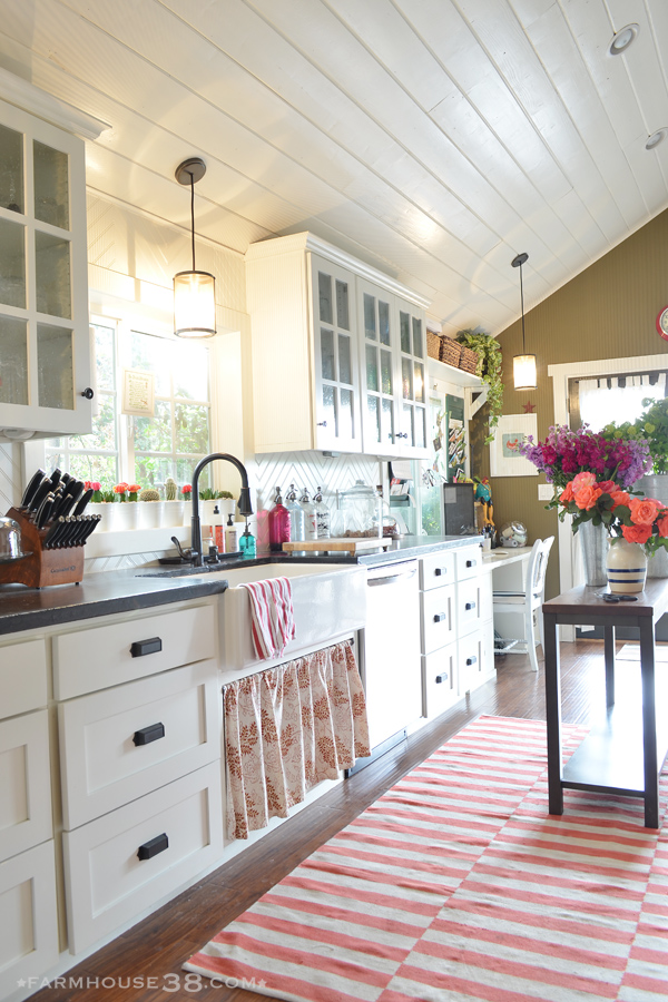 Eclectic Home Tour of Farm and Foundry - love her whimsical sense of style and this white kitchen with planked ceiling kellyelko.com