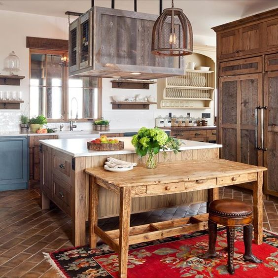 Love the natural wood in this farmhouse kitchen and the rustic farm table kellyelko.com