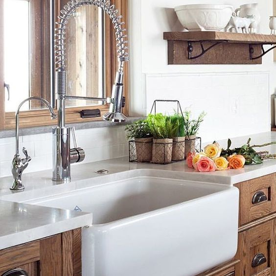 Love the farmhouse sink paired with a modern gooseneck faucet kellyelko.com