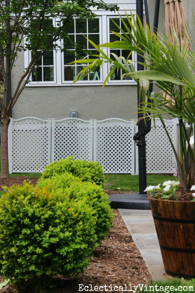 Hide an ugly air conditioning unit with these simple to install lattice privacy screens (just stake them into the ground - easy)! kellyelko.com