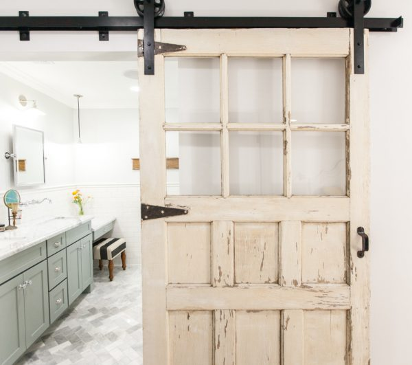 Love this chippy old sliding barn wood door in the bathroom kellyelko.com