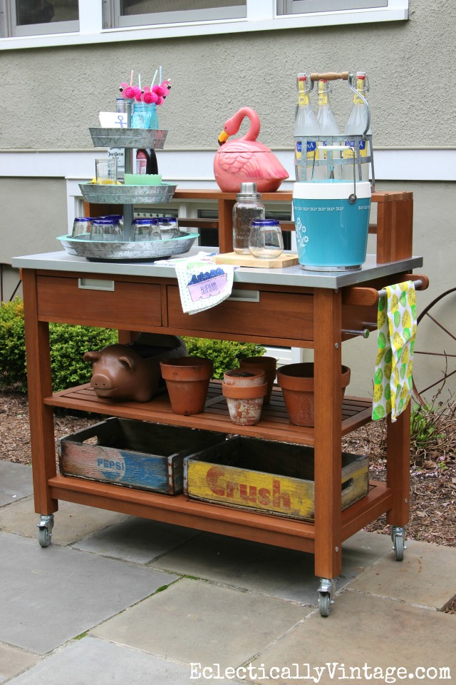 Simple Gardening Ideas - a potting table does double duty as a bar cart/serving area kellyelko.com #patio #patiodecor #pottingbench #gardening #vintagedecor