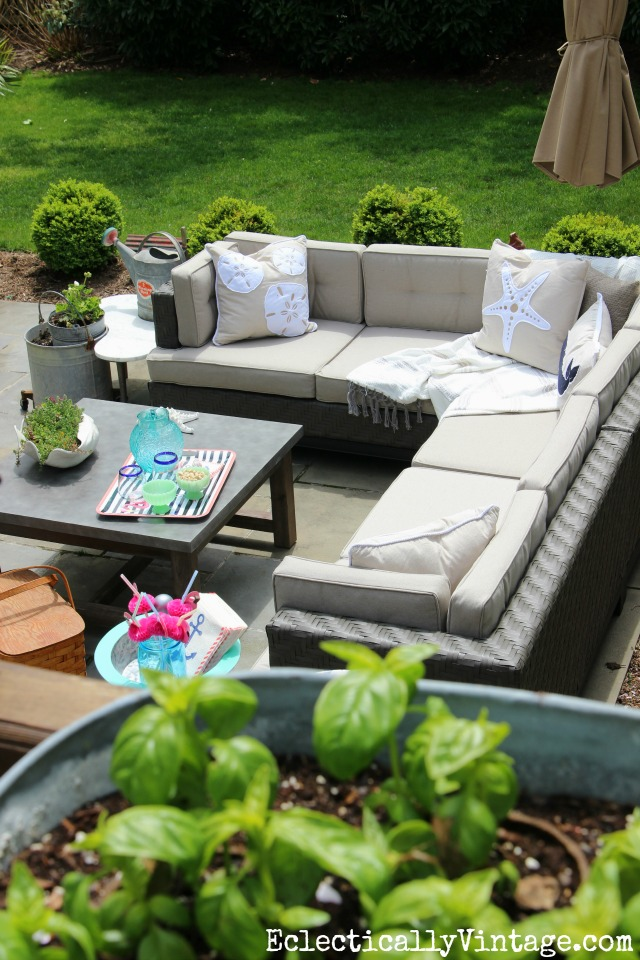 Love this cozy outdoor sectional sofa and concrete coffee table kellyelko.com