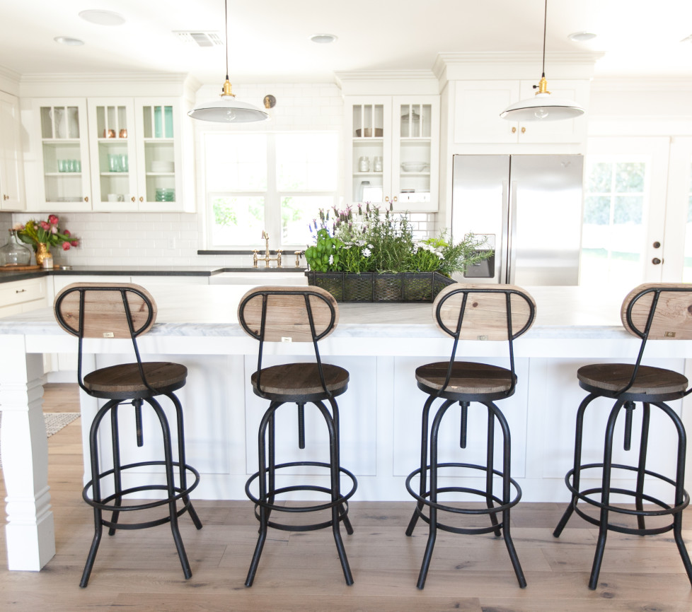 Farmhouse kitchen with industrial barstools kellyelko.com