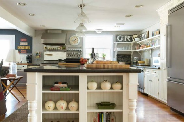 White farmhouse kitchen - love the open shelves and all the vintage signs kellyelko.com