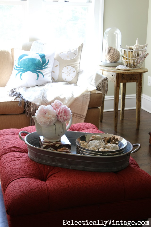 Coastal family room - love the crab pillow, shells, coral and rope monkey ball kellyelko.com