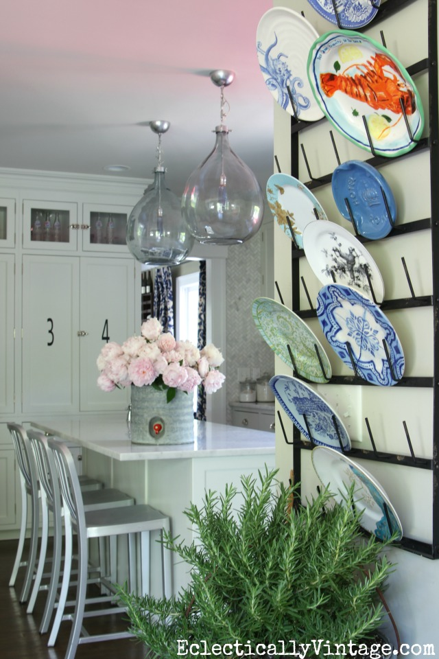 Love this gorgeous kitchen and her plate collection displayed on a glass drying rack kellyelko.com