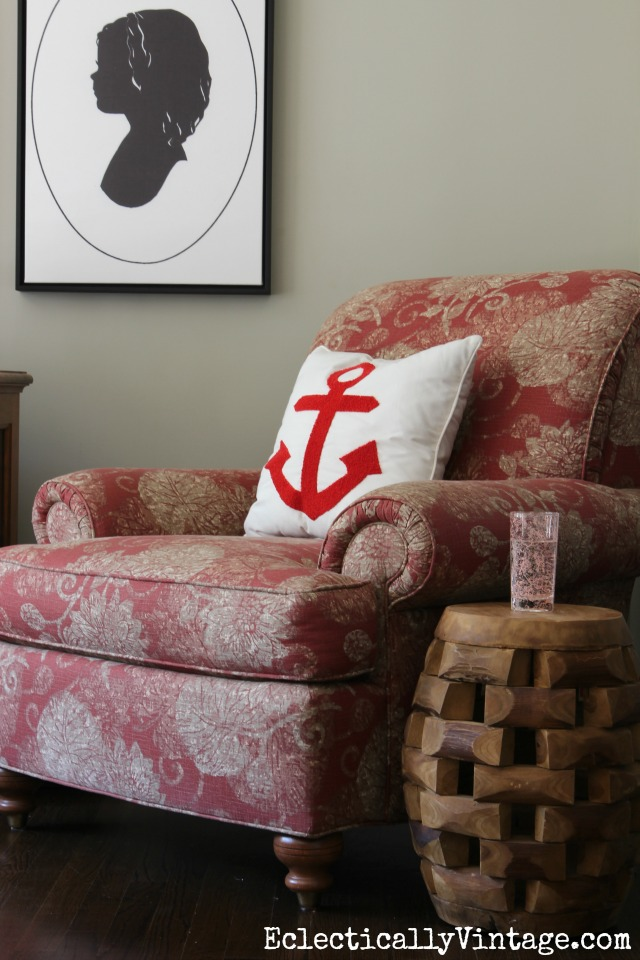 Cozy reading nook - love the anchor pillow and carved wood table kellyelko.com