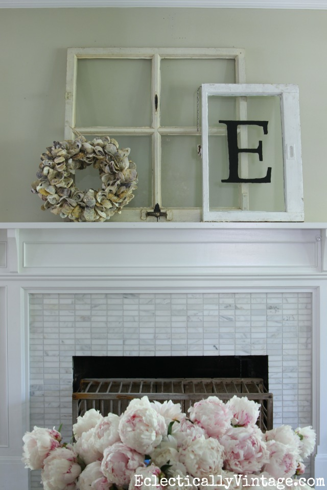 Love this summer mantel with vintage windows and an oyster shell wreath kellyelko.com