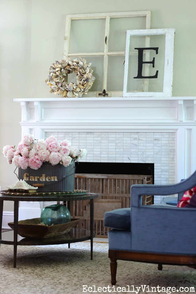 Summer mantel - love the old windows with oyster shell wreath and the huge bouquet of peonies! kellyelko.com