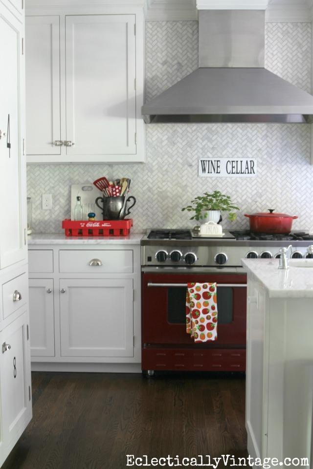 Gorgeous white kitchen with carrara marble herringbone tile backsplash kellyelko.com