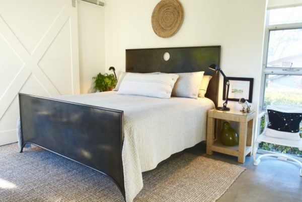 Love this black metal bed and the sliding barn door kellyelko.com