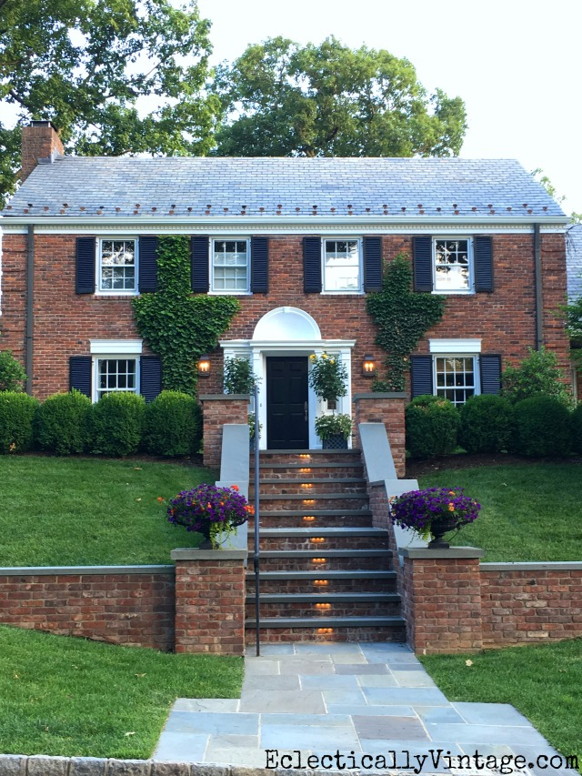 Love this brick colonial with ivy covered walls and classic planters kellyelko.com