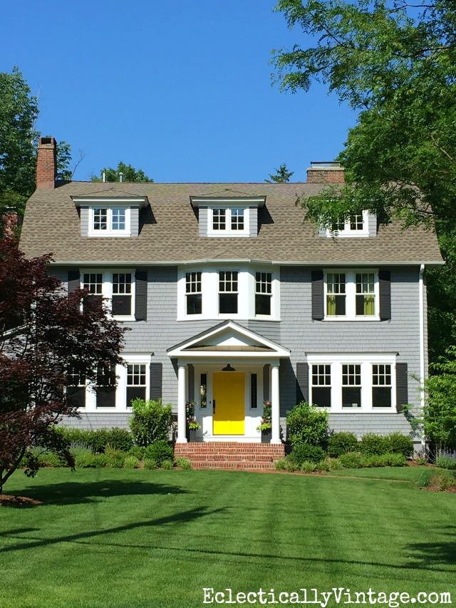 Curb appeal - love the gray house with a fun pop of color from a bright yellow door kellyelko.com