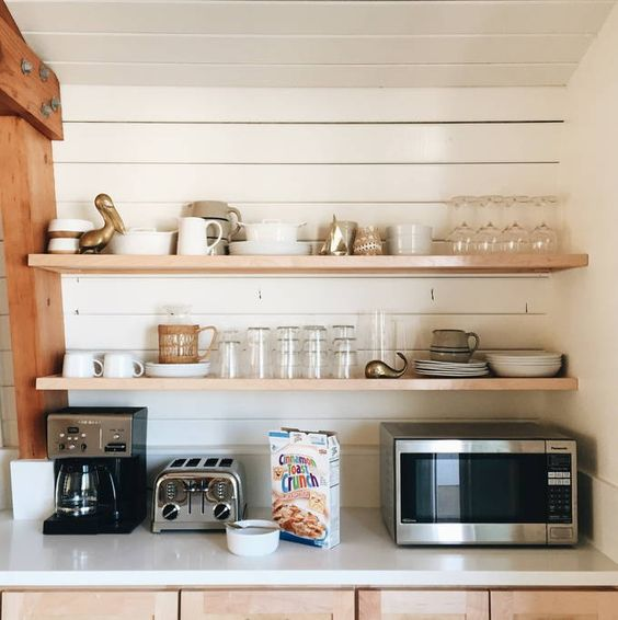 Love the floating shelves on the shiplap walls in this kitchen kellyelko.com