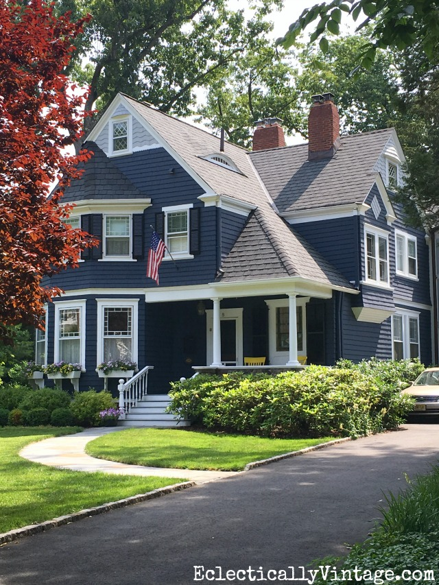 Blue House Exteriors - go bold with exterior paint like this dark blue with white trim kellyelko.com #bluehouses #bluepaint #curbappeal #bluehouse #paintcolors #exteriorpaint #blueexteriors